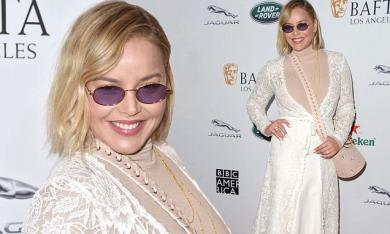Abbie Cornish commands attention in a striking lace ensemble and retro purple