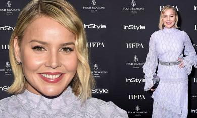 Abbie Cornish stuns in a sheer lace gown as she attends Toronto International Film Festival