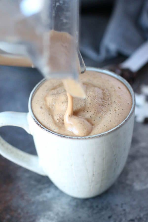 Gut Healing Cinnamon Coconut Latte being poured into a mug