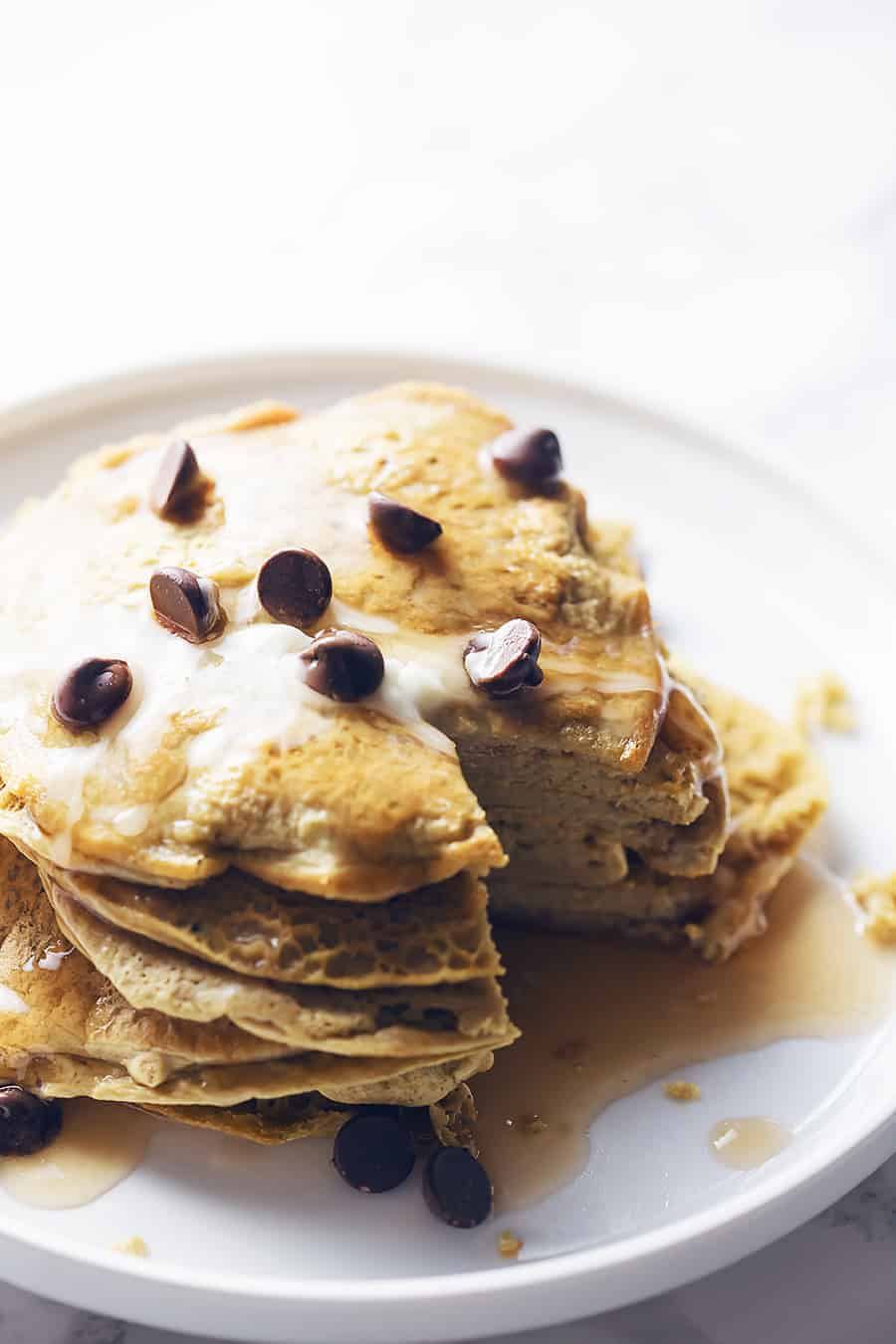 a stack of protein pancakes on a white plate